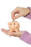 Moneybox en munten stock foto
