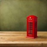 Moneybox för London telefonbås Arkivfoto