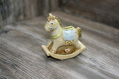 Moneybox in the form of a horse. Located on wooden background Stock Image