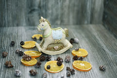 Moneybox in the form of a horse. Located on wooden background with some decor elements Stock Photography