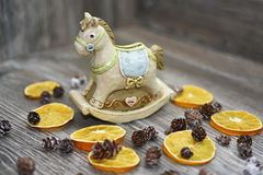 Moneybox in the form of a horse. Located on wooden background with some decor elements Royalty Free Stock Photos