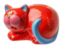 Moneybox in the form of a red cat. With a blue tail is isolated on a white background Stock Images