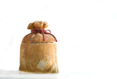 Moneybox in the form of the sack. Moneybox in the form of the Santa's sack Royalty Free Stock Image