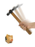 Moneybox and hammer in hand Stock Image