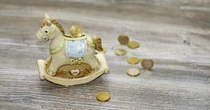 Moneybox i form av en häst Arkivfoton