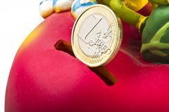 Moneybox red. With euro coin Royalty Free Stock Photos