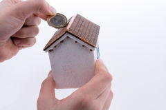 Moneybox in the shape of a model house Stock Photo
