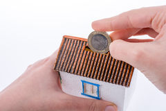 Moneybox in the shape of a model house Royalty Free Stock Images