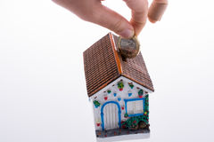 Moneybox in the shape of a model house Royalty Free Stock Photo