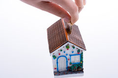 Moneybox in the shape of a model house Royalty Free Stock Image