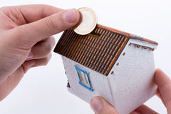 Moneybox in the shape of a model house Royalty Free Stock Photos