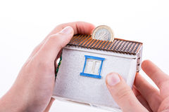 Moneybox in the shape of a model house Stock Photography