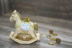 Moneybox sob a forma de um cavalo Fotos de Stock