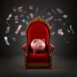 Moneybox svin på den kungliga biskopsstolen Arkivfoton