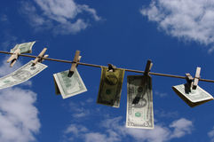 Moneylaundering. Money dried on clothesline skyline stock photos