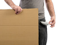 Moneyless. A moneyless man holding a cardboard sign with his pocket emptied out Stock Photography