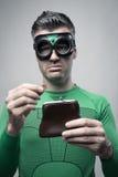 Moneyless superhero met lege beurs Royalty-vrije Stock Foto