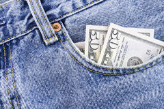 Moneynand jeans. Money in the pocket blue jeans Stock Images