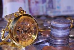 Moneys and clocks Royalty Free Stock Photo