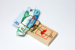 Moneytrap. Money (euro) caught in a mouse trap Stock Photo