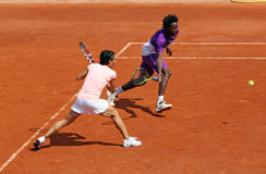 Monfils and Schiavone at Roland Garros 2011 Stock Images
