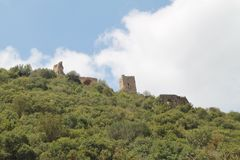 Monfort Fortress, Israel. Monfort crusaders fortress towers and buildings in view from the buttom of the hill Stock Image