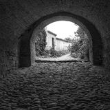 Monforte d'Alba (Cuneo); old alley. Black and white photo Royalty Free Stock Photography