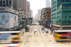 Mong Kok district, Kowloon, Hong Kong. Hong Kong - FEBRUARY 18: People crossing the street at Mong Kok district, Kowloon, Hong Kong on February 18, 2014 Royalty Free Stock Images