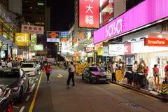 Mong Kok område på natten Arkivbilder