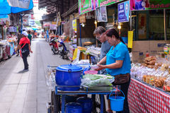 Monger and merchant selling traditional food at market in Sam Chuk District, Suphan Buri, Thailand Royalty Free Stock Photos