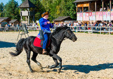Mongol on black horse. The Mongol rides on black horse on the stadium royalty free stock images