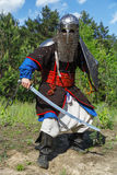 Mongol horde warrior. In armour holding traditional saber stock photos