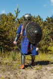 Mongol horde warrior. In armour holding traditional saber royalty free stock photography