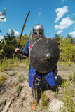 Mongol horde warrior. In armour holding traditional saber stock photo