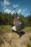 Mongol warrior in armour. Mongol horde warrior in armour holding traditional saber royalty free stock photos