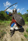 Mongol warrior in armour. Mongol horde warrior in armour holding traditional saber royalty free stock image