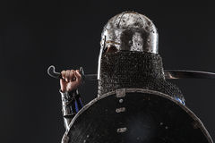 Mongol warrior in armour. Mongol horde warrior in armour holding traditional saber royalty free stock photography