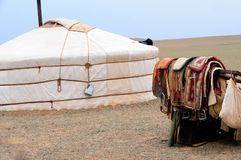 Mongolia – nomad gers (yurt) with horse saddles. Nomad gers, or yurts, in the Yol Valley, Gobi Desert steppes, Mongolia with horse saddles Stock Photography