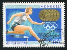 Runner Fanny Blankers-Koen. MONGOLIA - CIRCA 1968: stamp printed by Mongolia, shows runner, Fanny Blankers-Koen, circa 1968 Stock Photo