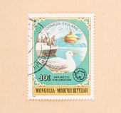 A stamp printed in Mongolia shows a submarine, boat and a bird, circa 1980. MONGOLIA - CIRCA 1980: A stamp printed in Mongolia shows a submarine, boat and a bird stock images