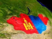 Mongolia with flag on Earth Stock Image