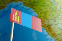 Mongolia flag with a globe map as a background Stock Photo