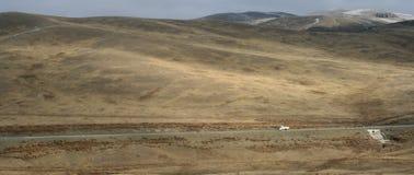 Mongolia - highway. Main road on the edge of the Gobi desert linking Beijing with Irkutsk Stock Photos