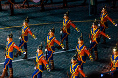 The Mongolia Honor Guard and the Central Military Band of the Armed Forces from Mongolia at the Red Square. MOSCOW, RUSSIA - AUGUST 26, 2016: Spasskaya Tower Royalty Free Stock Images