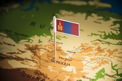 Mongolia marked with a flag on the map.  stock images