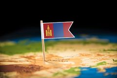 Mongolia marked with a flag on the map.  stock photography