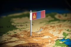 Mongolia marked with a flag on the map.  royalty free stock images