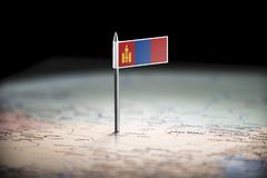 Mongolia marked with a flag on the map.  stock image