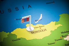 Mongolia marked with a flag on the map.  royalty free stock photo