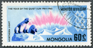 MONGOLIA - 1965: shows Northern lights and polar bears, series International Quiet Sun Year Stock Photos